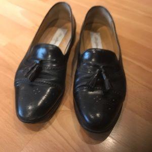 Men's black leather tassel loafers by Mezlan